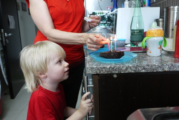 Waiting to blow out the candles.
