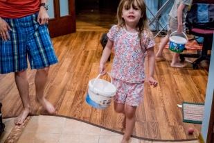 Quora looks for eggs with her Easter Bucket