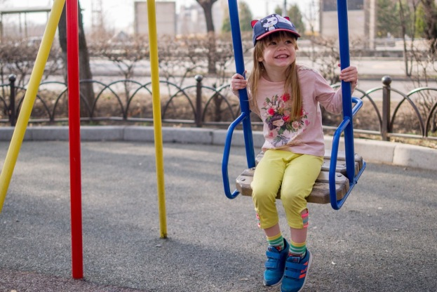 Swinging by herself
